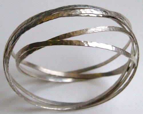 Tensioned hammered sterling silver ribbon bracelet