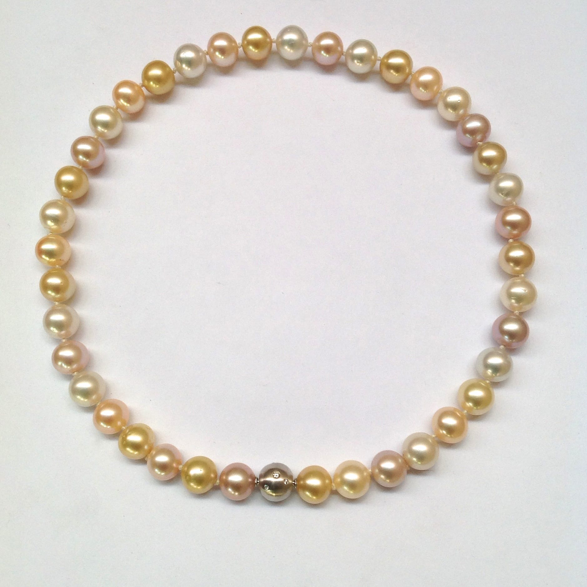 Pink freshwater pearls with white and golden South sea pearls, 10mm in diameter. 18 carat white gold clasp studded with 12 diamonds.