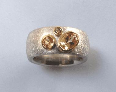 Serling silver, 18 carat yellow gold, imperial topaz, citrine, cinnamon diamonds