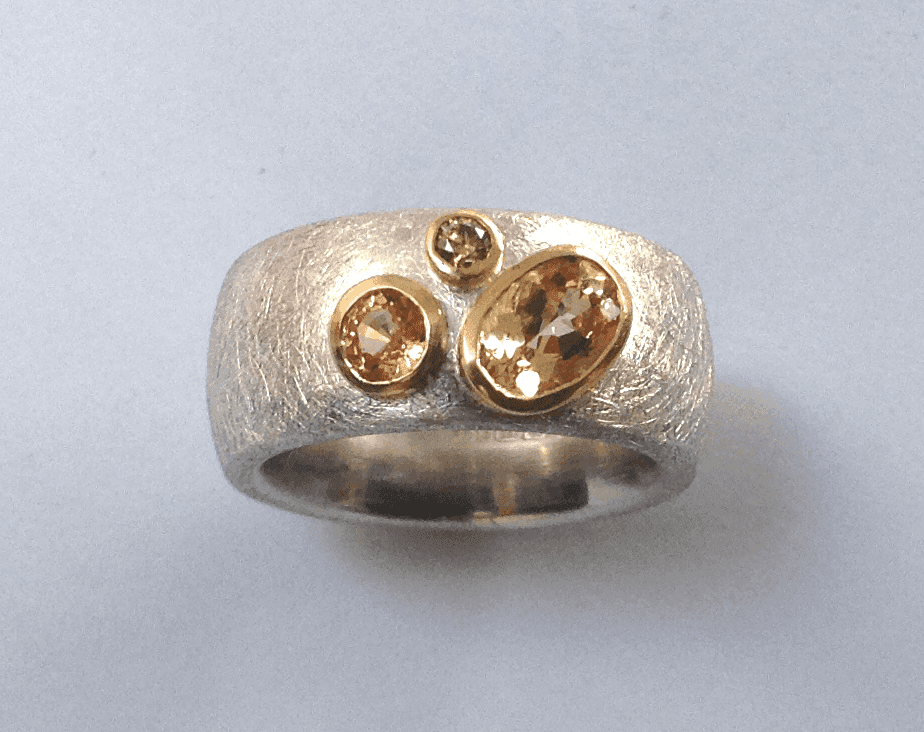 Serling silver, 18 carat yellow gold, imperial topaz, citrine, cinnamon diamonds