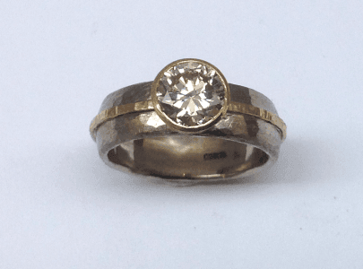 18 carat white and yellow gold, diamond