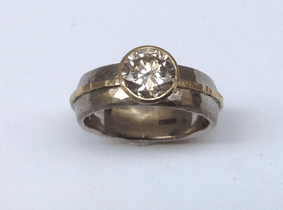 18 carat white and yellow gold, diamond