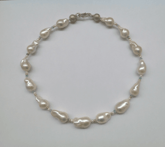 Sterling silver, 18 carat yellow gold, baroque pearls, aquamarine
