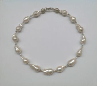 Sterling silver, 18 carat yellow gold, baroque pearls, aquamarine