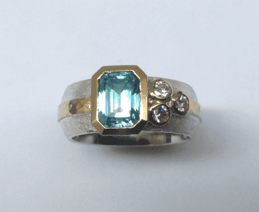 Sterling silver, 18 carat yellow gold, blue zircon diamonds