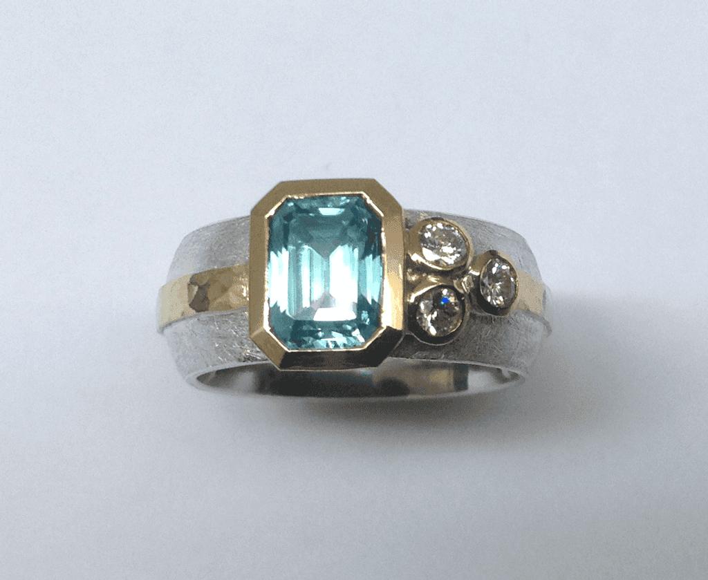 Sterling silver, 18 carat yellow gold, blue zircon diamonds
