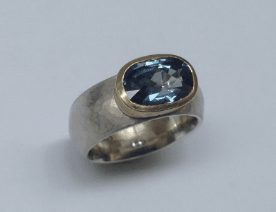 Sterling silver, 18 carat yellow gold, blue sapphire