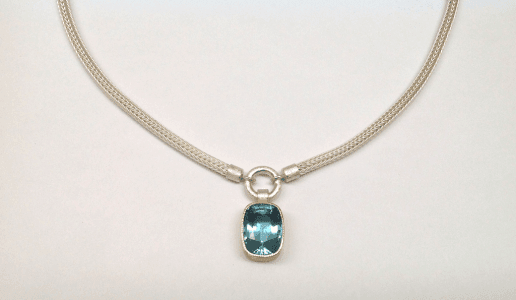 Sterling silver, 18 carat yellow gold, aquamarine
