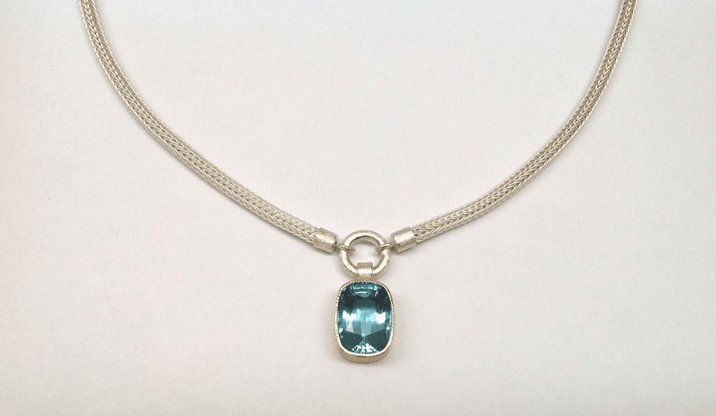 Sterling silver, 18 carat yellow gold, aquamarine