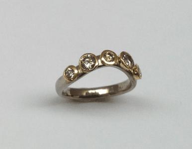 18 carat white and yellow gold, cinnamon diamonds