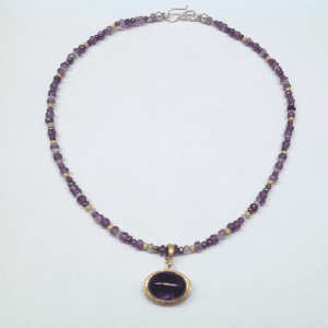 Sterling silver, amethyst, 18 carat yellow gold