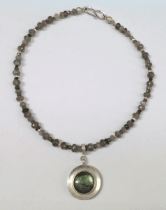Sterling silver, 18 carat yellow gold, labradorite
