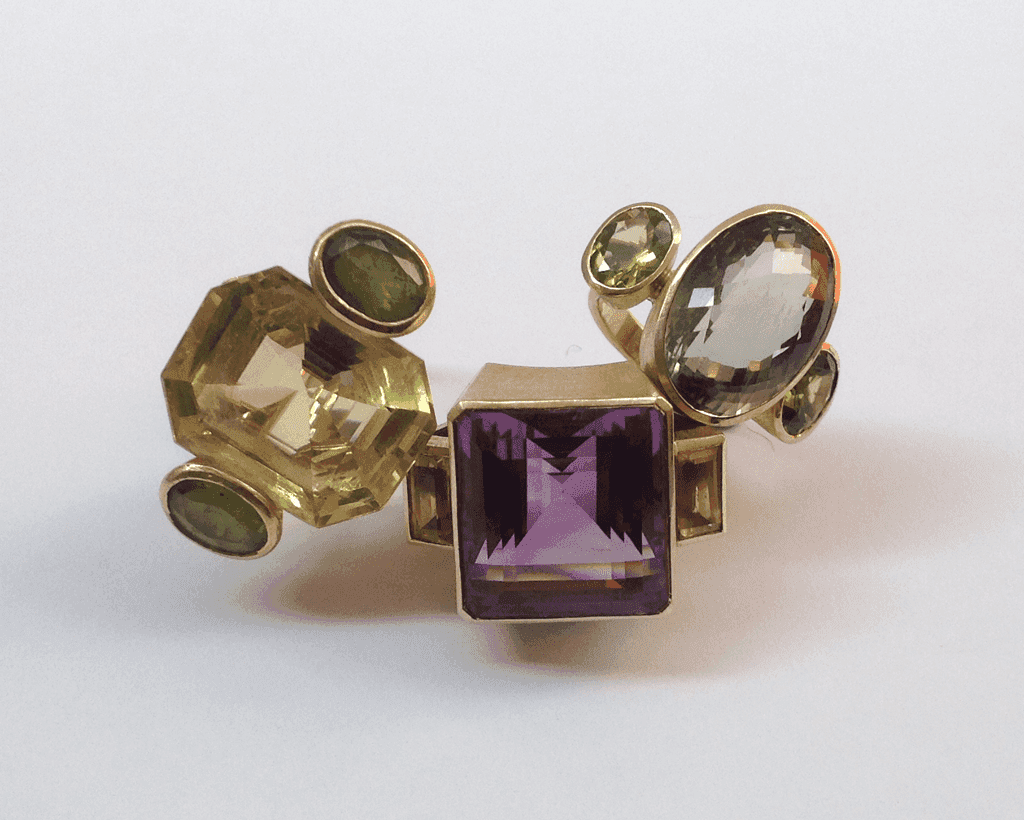Large 18 carat gold cocktail rings, various gemstones