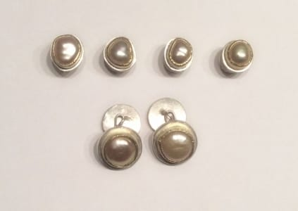 Shirt studs and matching cufflinks. Natural coloured freshwater pearls set in 18 carat yellow gold, sterling silver base.