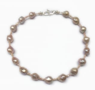 Pink freshwater baroque pearls, 18 carat yellow gold beads, sterling silver clasp