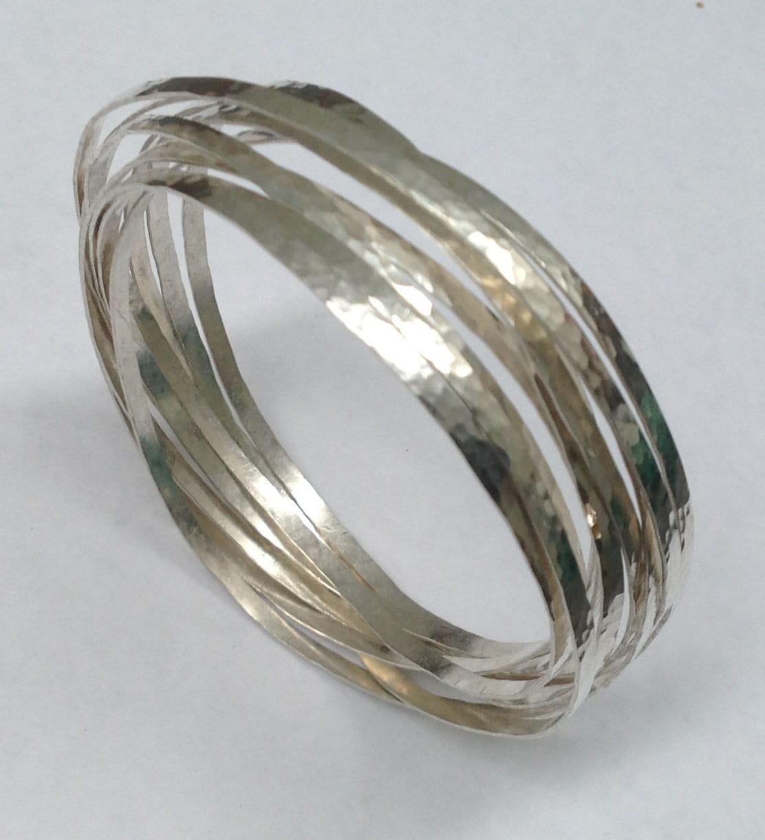Tensioned hammered sterling silver ribbon bracelet