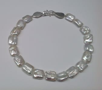 Cushion shaped silver white freshwater pearls, sterling silver clasp