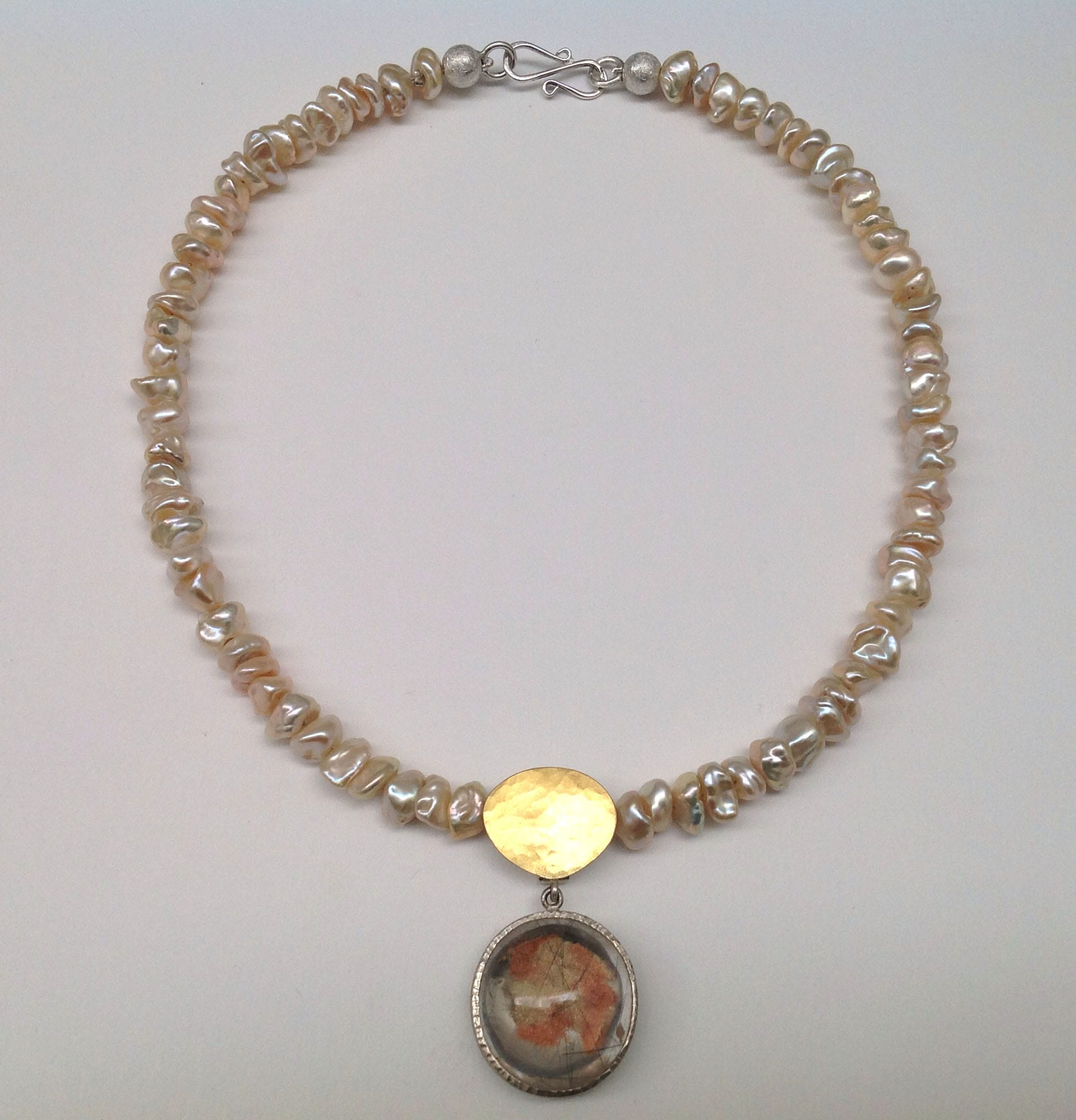 Natural colour freshwater baroque pearls, quartz pendant set in sterling silver with 22 carat gold detail