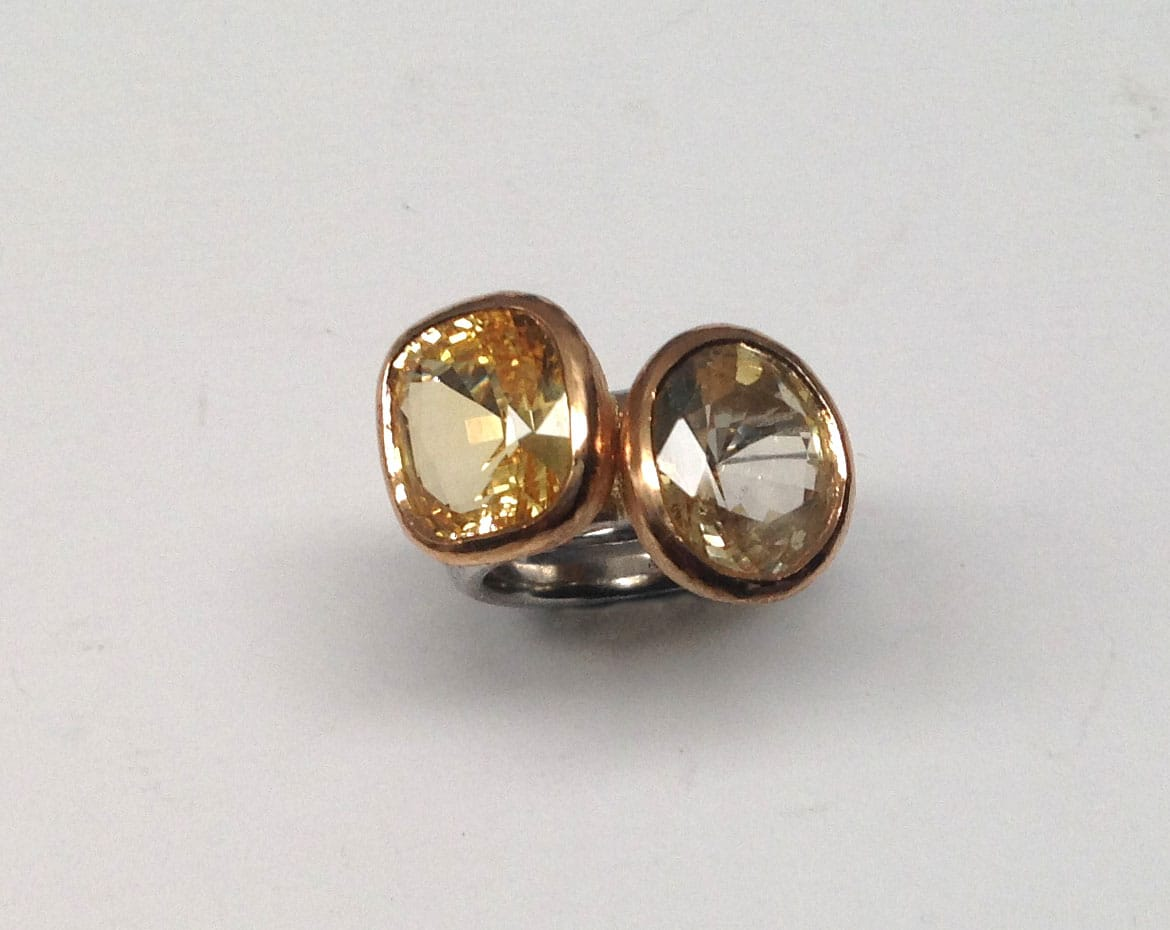 Two rings to be worn together. Yellow sapphires set in 22 carat gold, platinum shanks.