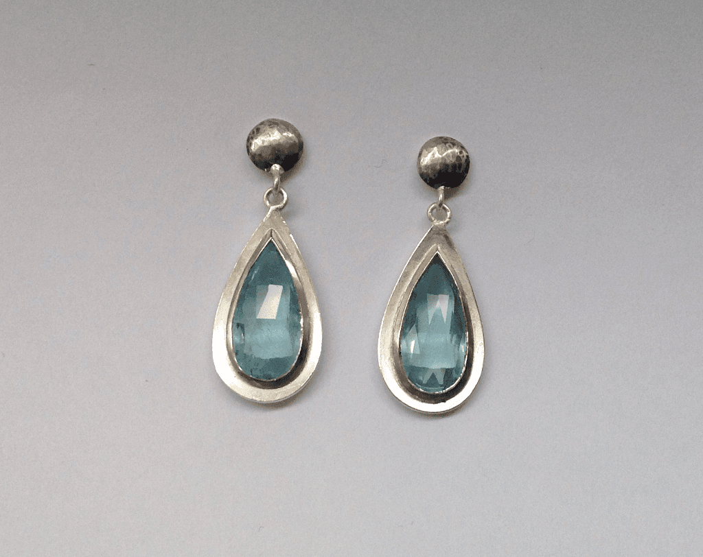 Aquamarine drops set in 18 carat white gold, sterling silver
