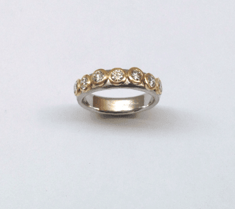 Diamonds set in 18 carat yellow gold on platinum band