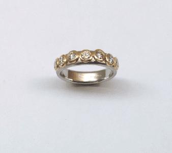 Diamonds set in 18 carat yellow gold on platinum band