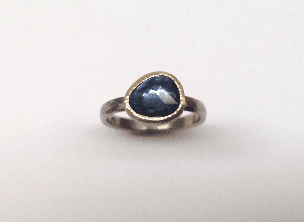 Organic shaped rose cut sapphire set in 18 carat gold, sterling silver