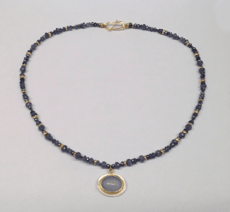 Chalcedony set in 18 carat yellow gold and sterling silver, sapphire, tanzanite and 18 carat yellow gold beads and peacock pearls