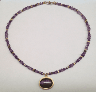 Purple labradorite set in 18 carat yellow gold, amethyst and 18 carat yellow gold beads, peacock pearls