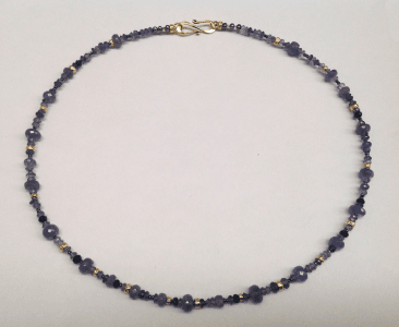 Tanzanite, sapphire, iolite, and 18 cart yellow gold beads, peacock pearls