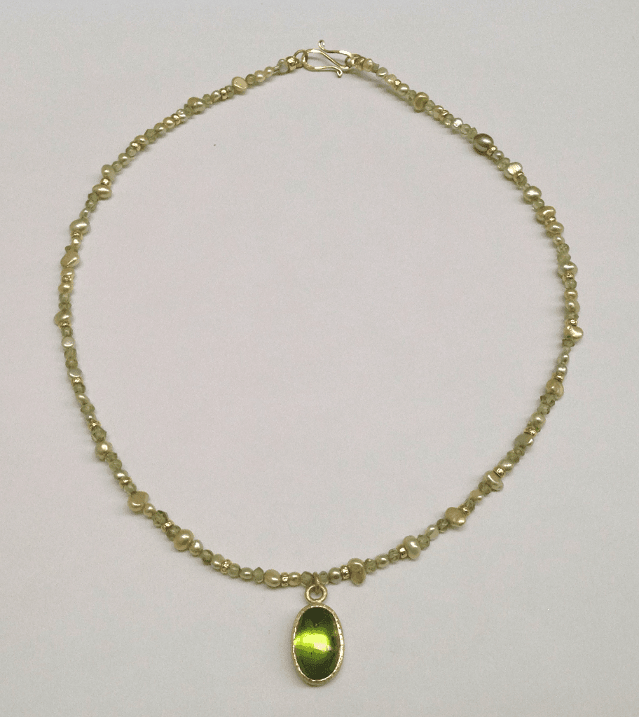 Peridot set in 18 carat yellow gold, peridot beads, freshwater pearls