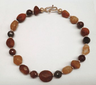 Yellow opal, tourmaline and carnelian beads, 18 carat yellow gold beads