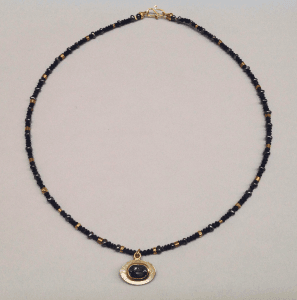 Blue tourmaline set in 18 carat yellow gold, sterling silver, lapis lazuli and 18 carat yellow gold beads, peacock pearls