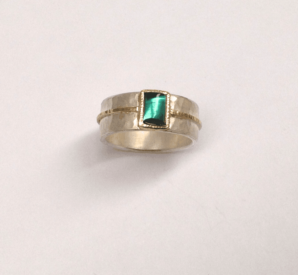 Green tourmaline set in 18 carat yellow gold, sterling silver