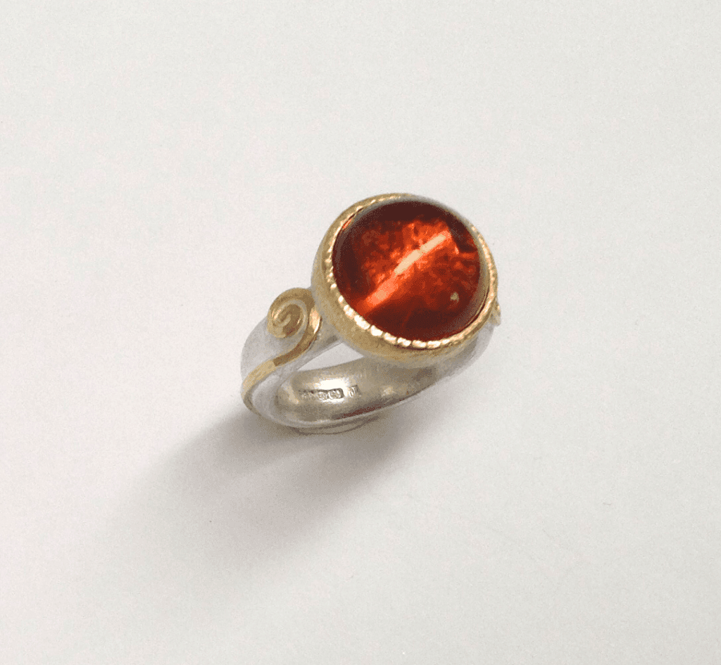 Madeira citrine set in 18 carat yellow gold, sterling silver