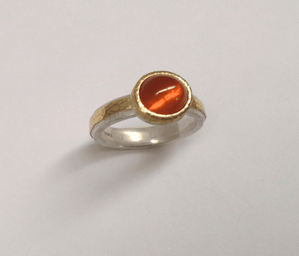 Mandarin garnet set in 18 carat yellow gold, sterling silver