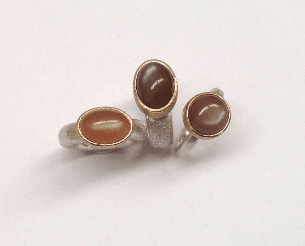 Fawn and cinnamon moonstones set in 9 carat rose gold, sterling silver