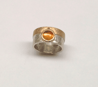 Fire opal set in 9 carat rose gold, cinnamon diamond, sterling silver
