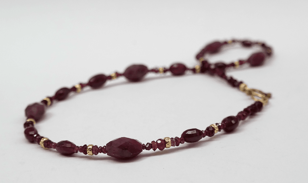 Ruby beads, 18 carat yellow gold beads