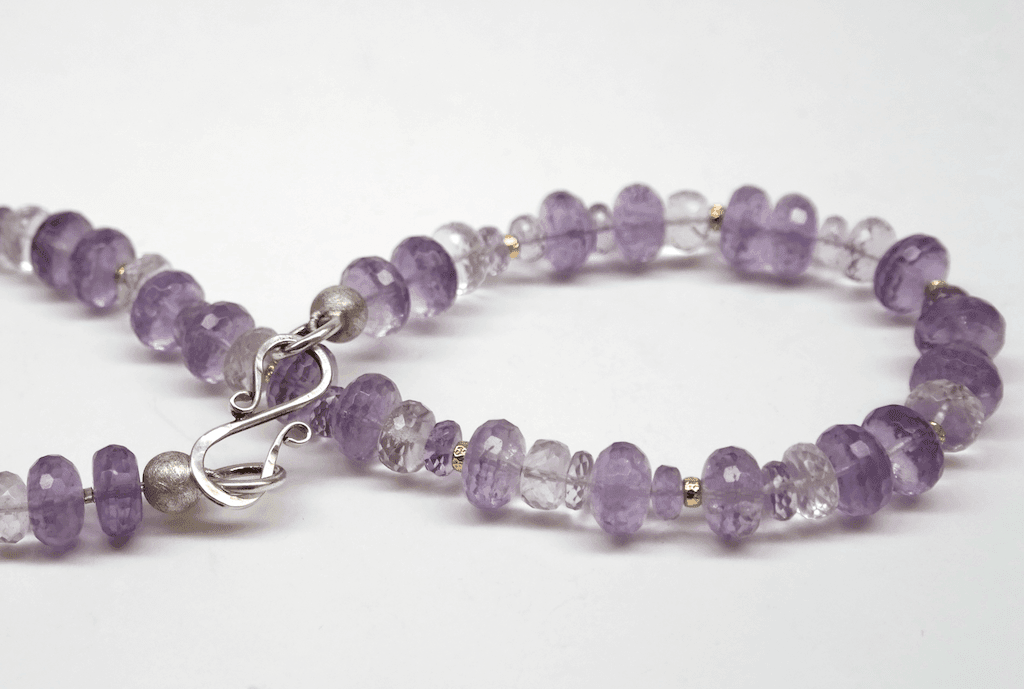 Amethyst and kunzite beads, 18 carat yellow gold beads