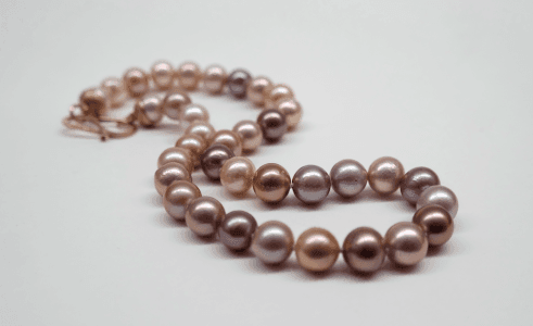 Natural intense pink freshwater pearls, 9 carat rose gold clasp