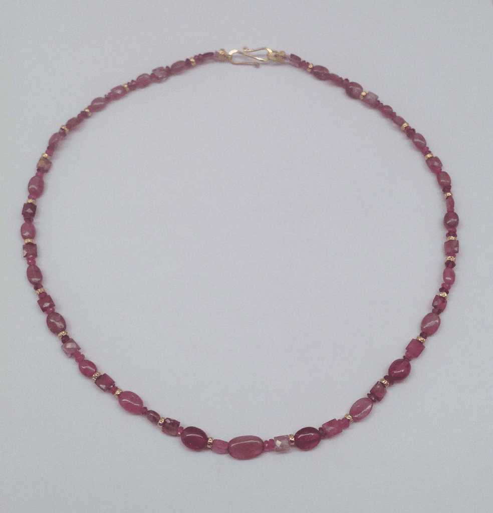 Pink tourmaline beads, pink pearls, 18 carat yellow gold beads