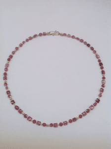 Pink tourmaline and garnet beads, pink pearls and 18 carat gold yellow beads