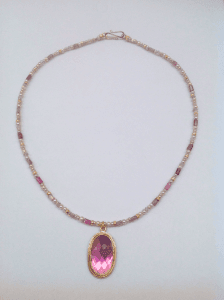 Pink tourmaline set in 18 carat yellow gold, pink pearls and tourmaline beads