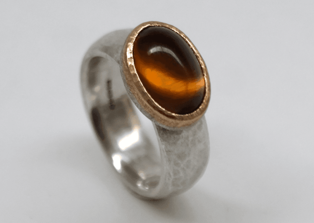 Citrine set in 22 carat gold, sterling silver