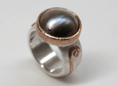 Blue mabe pearl set in 18 carat rose gold, sterling silver