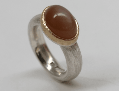 Fawn moonstone set in 9 carat rose gold, sterling silver