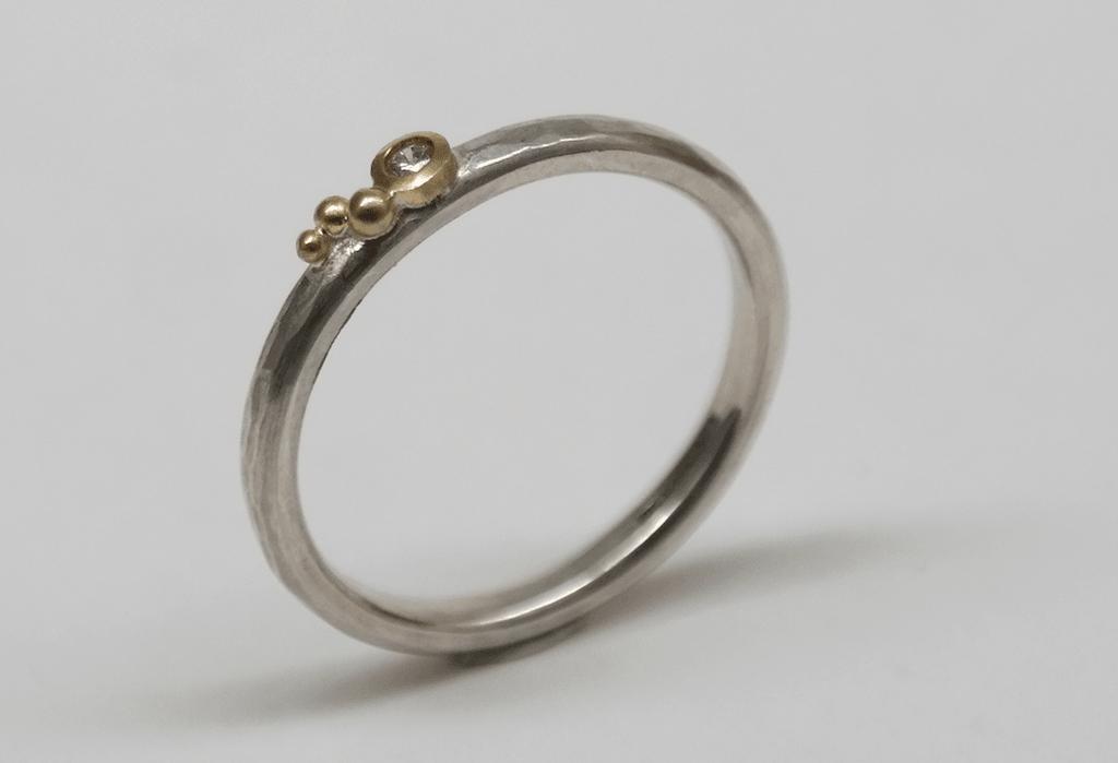 Diamond set in 18 carat yellow gold, 18 carat yellow gold detail, sterling silver