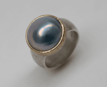 Blue mabe pearl set in 9 carat rose gold, sterling silver
