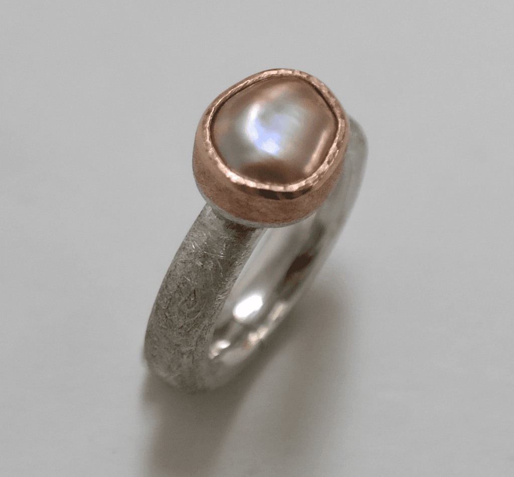 Pink baroque pearl set in 18 carat rose gold, sterling silver